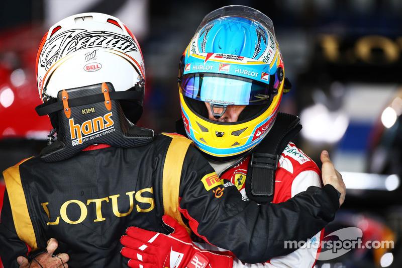 Race winner Kimi Raikkonen, Lotus F1 Team celebrates in parc ferme with Fernando Alonso, Ferrari