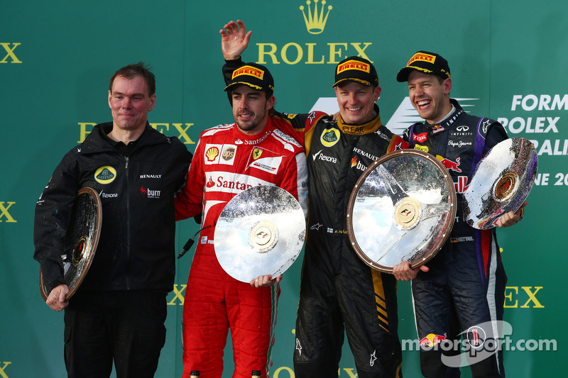 The podium, Renault Race Engineer; Fernando Alonso, Ferrari, second; Jenson Button, McLaren, race winner; Fernando Alonso, Ferrari, third