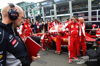 Adrian Newey, Red Bull Racing Chief Technical Officer looks at the Ferrari F138 on the grid