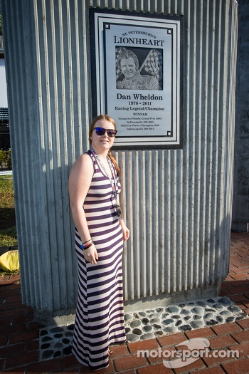 Dan Wheldon Memorial and Victory Circle unveiling ceremony: sister of Dan Wheldon poses with the Dan Wheldon Memorial