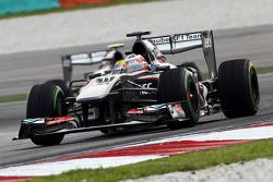 Nico Hulkenberg, Sauber C32 leads team mate Esteban Gutierrez, Sauber C32