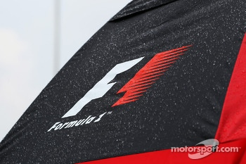 F1 umbrella covered in rain drops