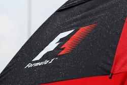 F1 umbrella covered in rain drops