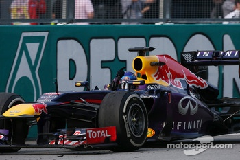 Race winner Sebastian Vettel, Red Bull Racing RB9 celebrates at the end of the race