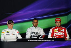 The top three qualifiers in the FIA Press Conference, Lotus F1 Team, second; Lewis Hamilton, Mercedes AMG F1, pole position; Fernando Alonso, Ferrari, third.  Formula 1 World Championship, Rd 3, Chinese Grand Prix, Shanghai, China, Qualifying Day. - www.x