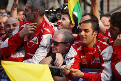 Ker Robertson, Getty Images in with the Ferrari team at parc ferme
