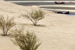Jenson Button, McLaren MP4-28 leads Esteban Gutierrez, Sauber C32
