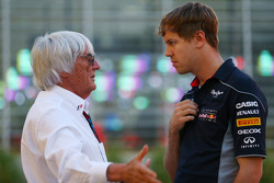 (L to R): Bernie Ecclestone, CEO Formula One Group, talks with Sebastian Vettel, Red Bull Racing