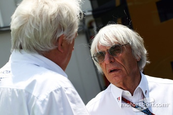(L to R): Charlie Whiting, FIA Delegate with Bernie Ecclestone, CEO Formula One Group (FOM)