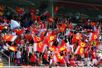 Ferrari fans wave their flags