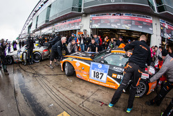 Pit stop for #187 Team Extreme Racing BMW Z4 (V5): Axel Duffner, Jaber Alkhalifa, Abdulazis Al Faisal, Rainer Kathan