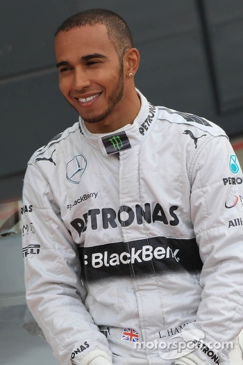 Lewis Hamilton poses for photographs