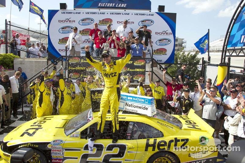 Race winner Joey Logano celebrates