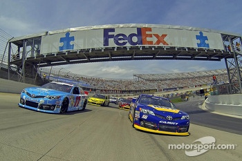 Denny Hamlin, Joe Gibbs Racing Toyota and Martin Truex Jr., Michael Waltrip Racing Toyota lead the field during pace laps