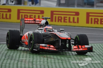 Jenson Button, McLaren MP4-28 runs wide at the final chicane