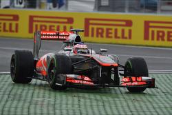 Jenson Button, McLaren MP4-28 runs wide at the final chicane