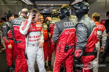 Tom Kristensen celebrates pole position with Audi Sport team members