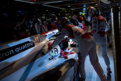Allan McNish getting out of the #2 Audi and Loic Duval getting in