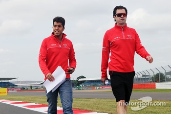 Rodolfo Gonzalez, Marussia F1 Team Reserve Driver and Marc Hynes, Marussia F1 Team Driver Coach walk the circuit.
