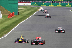 Jenson Button McLaren MP4-28 and Mark Webber Red Bull Racing RB9 battle for position