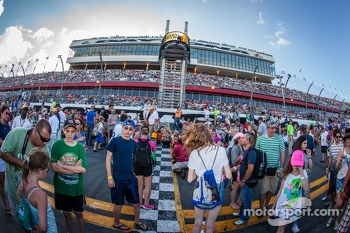 Fans watch the pre-race concert