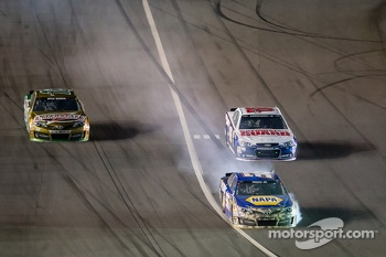 Martin Truex Jr., Michael Waltrip Racing Toyota smokes the brakes