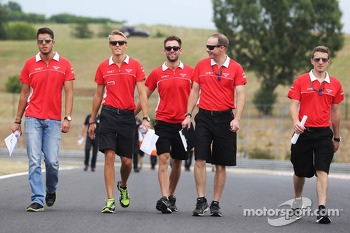 Max Chilton, Marussia F1 Team and Rodolfo Gonzalez, Marussia F1 Team Reserve Driver walk the circuit
