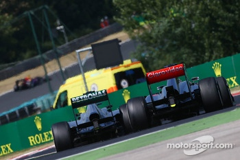 Jenson Button, McLaren MP4-28 and Lewis Hamilton, Mercedes AMG F1 W04 battle for position