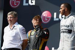 The podium, Ross Brawn, Mercedes AMG F1 Team Principal; Kimi Raikkonen, Lotus F1 Team, second; Lewis Hamilton, Mercedes AMG F1, race winner