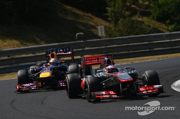 Jenson Button, McLaren leads Sebastian Vettel, Red Bull Racing