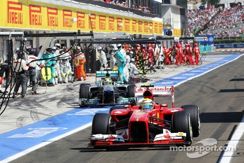 Felipe Massa, Ferrari F138 and Nico Rosberg, Mercedes AMG F1 W04 leave the pits