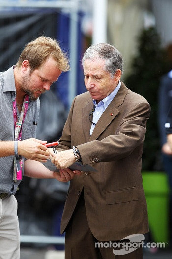 Jean Todt, FIA President signs autographs for the fans