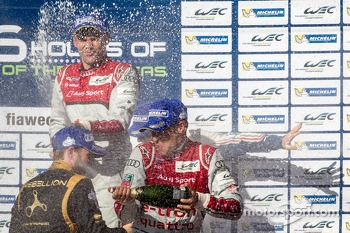 LMP1 podium: champagne for Tom Kristensen, Loic Duval and Nick Heidfeld