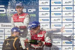 LMP1 podium: champagne for Tom Kristensen, Loic Duval and Nick Heidfeld