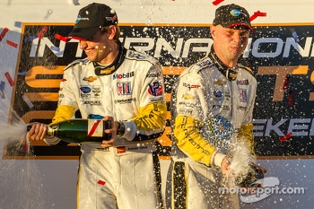 GT podium: champagne for Antonio Garcia and Jan Magnussen