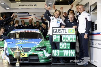 Race winner Augusto Farfus celebrates with team