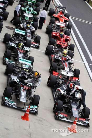 Lewis Hamilton, Mercedes AMG F1 W04 and Nico Hulkenberg, Sauber C32 head the field in parc ferme