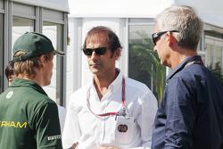 Charles Pic, Caterham, with Emanuele Pirro, FIA Steward