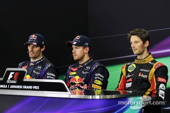 The FIA Press Conference: Mark Webber, Red Bull Racing, second; Sebastian Vettel, Red Bull Racing, race winner; Romain Grosjean, Lotus F1 Team, third