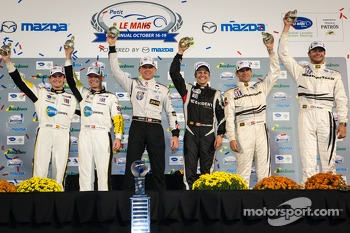 2013 GT champions Jan Magnussen, Antonio Garcia, 2013 P2 champion Scott Tucker, 2013 PC champion Chris Cumming, 2013 GTC champions Jeroen Bleekemolen, Cooper MacNeil