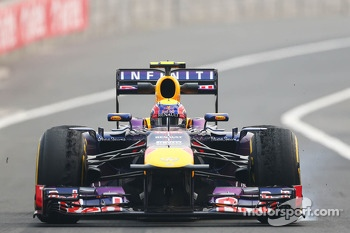 Mark Webber, Red Bull Racing RB9 with worn Pirelli tyres