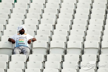 A circuit worker alone in the grandstand