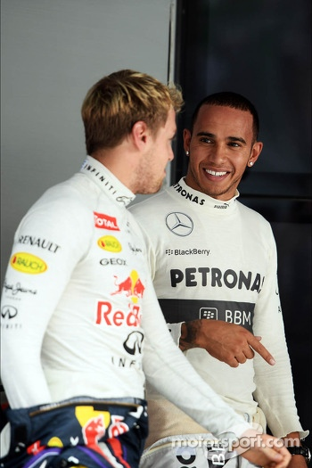 (L to R): pole sitter Sebastian Vettel, Red Bull Racing with Lewis Hamilton, Mercedes AMG F1