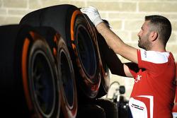 A Ferrari worker with Pirelli tires