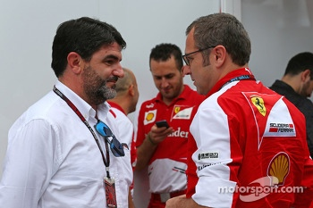 (L to R): Luis Garcia Abad, Driver Manager of Fernando Alonso, Ferrari with Stefano Domenicali, Ferrari General Director