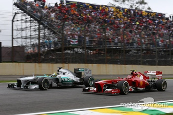 Nico Rosberg, Mercedes AMG F1 W04 and Felipe Massa, Ferrari F138 battle for position