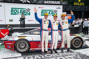 P class victory lane: class and overall winners Christian Fittipaldi, Joao Barbosa and Sébastien Bourdais