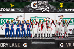 GTD podium: class winners Nelson Canache, Spencer Pumpelly, Tim Pappas, Markus Winkelhock, second place Madison Snow, Jan Heylen, Marco Seefried, third place Maurizio Mediani, Sergey Zlobin, Boris Rotenberg, Mika Salo, Mikhail Aleshin
