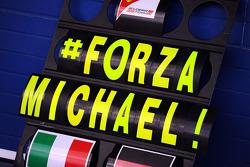 F1: A Ferrari pit board showing support for Michael Schumacher