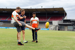 (L to R): Nico Hulkenberg, Sahara Force India F1 practices his Aussie Rules skills with Shaun Higgins, Western Bulldogs Australian Rules Footballer and Sergio Perez, Sahara Force India F1 at Whitten Oval